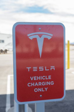 BAKER, USA - FEBRUARY 16, 2018: Tesla Supercharger charging station for recharging electric vehicles at Baker in southern California