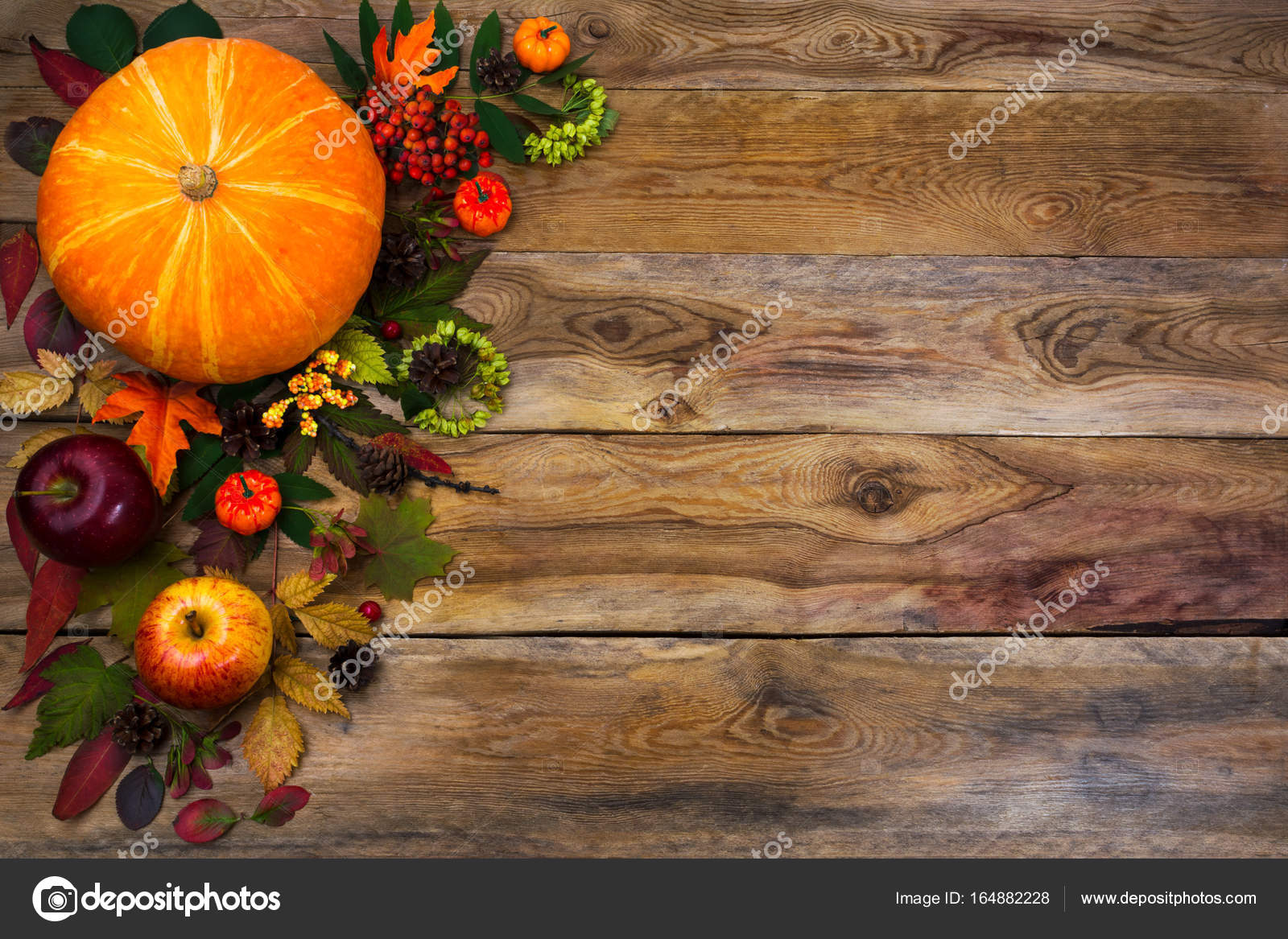 Happy Thanksgiving Decor With Pumpkin Apples And Autumn Leaves On The Left Side Of Rustic Wooden Table Fall Background Seasonal Vegetables Fruits