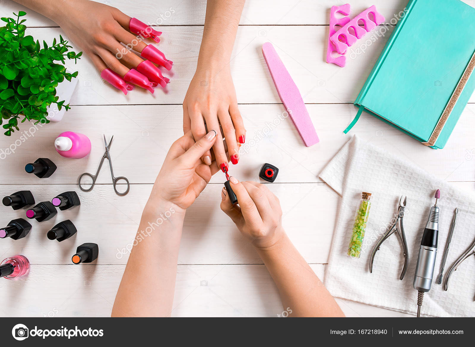 Nail care. Closeup of female hands filing nails with professional ...