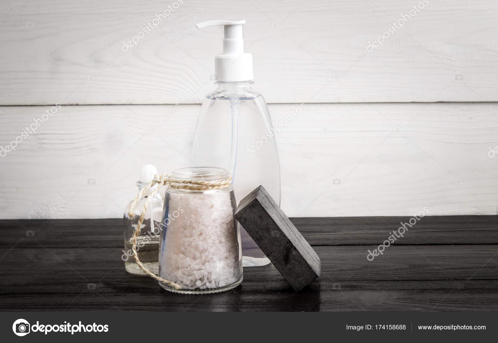 Spa still life. Aroma oils, stones, soap, sea salt and shampoo on ...