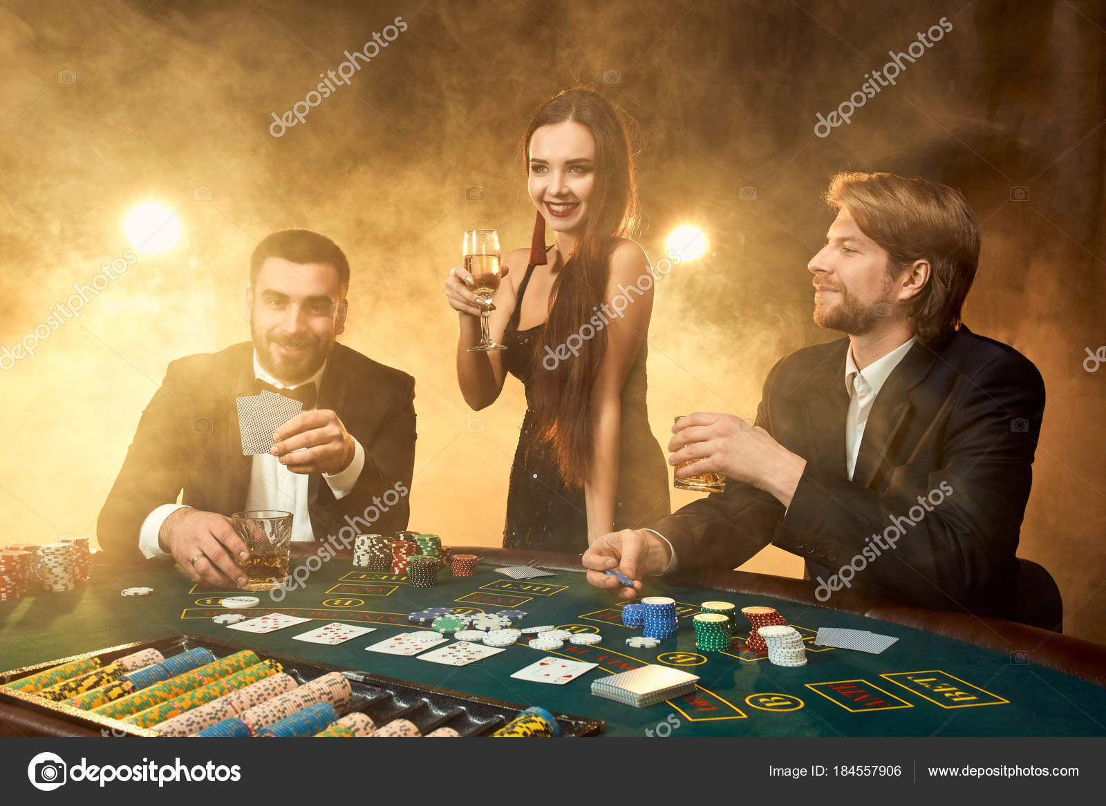 Group Of Young Rich People Is Playing Poker In The Casino Stock
