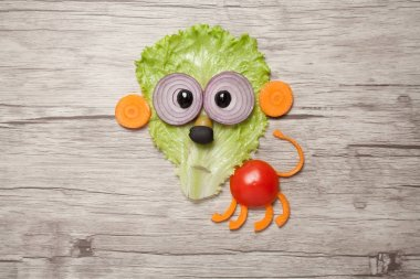 Funny lion made of vegetables on wooden table