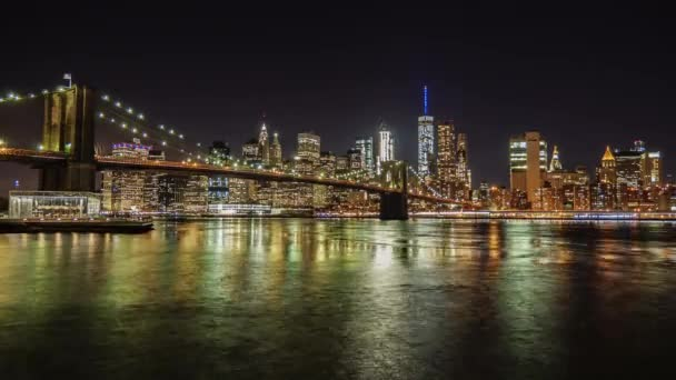 Night Manhattan and Brooklyn Bridge. The famous business district of New York. The flow of the river beautifully describes the following