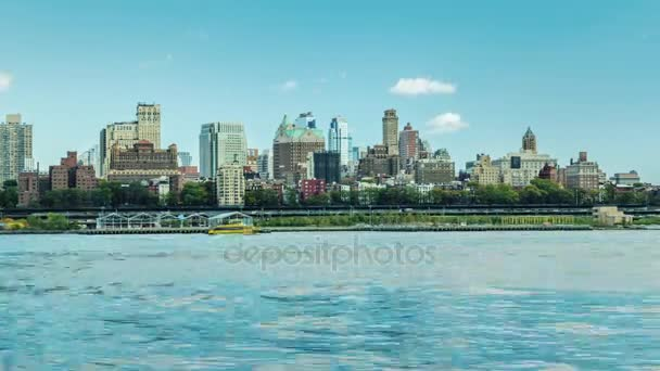 New York, USA: View of Brooklyn skyline from Manhattan across the river. Intensive traffic on the river