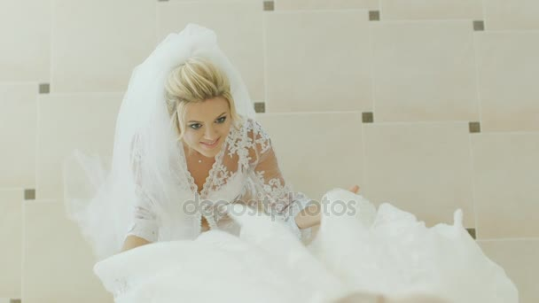 Blonde Bride admires her wedding dress. View from above– stock footage b2b95c03d