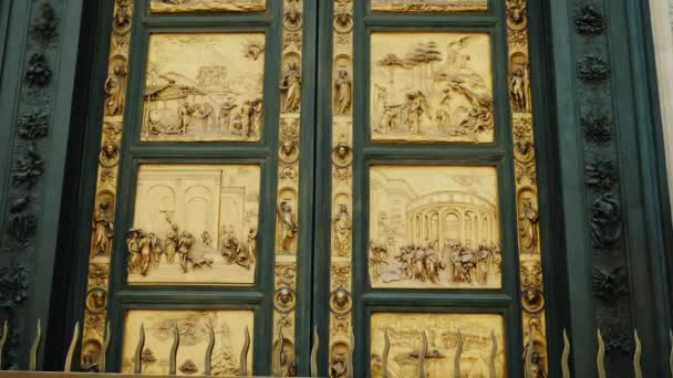 Golden doors with scenes from the Old Testament. Near Baptistry Duomo Santa Maria del Fiore & Golden doors with scenes from the Old Testament. Near Baptistry ...