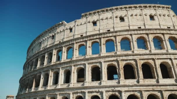 Famous coliseum in Rome, Italy. Low angle video, pan shot