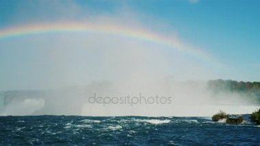 A beautiful rainbow over the Niagara River. In front of Niagara Falls. Beautiful nature of Canada and the USA