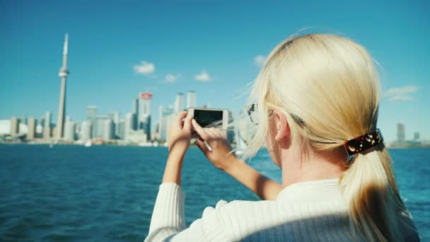 A woman takes a beautiful view of Toronto. Tourism in Canada and travel concept