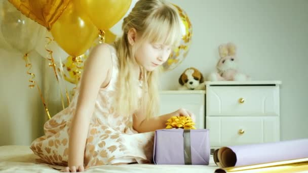 Blonde Girl 7 Years Wrapped A Box Of Gifts In Paper Birthday Concept Stock Footage