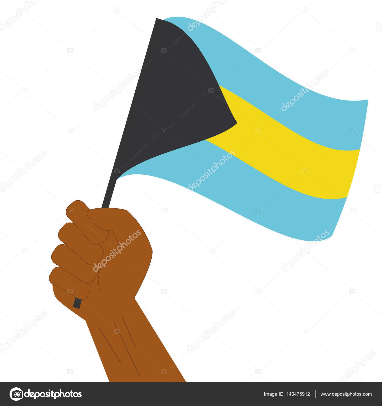 Explotación de la mano y levantando la bandera nacional de Bahamas ...