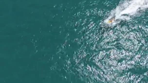 Man Speeding Jet Ski Rider Splash Through The Sea