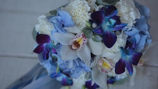 wedding bouquet with blue flowers. wedding bouquet on wooden background