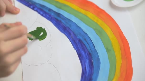 girls draw a rainbow with watercolor paints and brushes, childrens joint creativity.