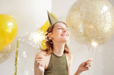Young woman in birthday cap