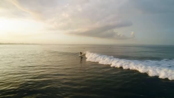 Surfing: Surfer man riding on the blue waves slow motion