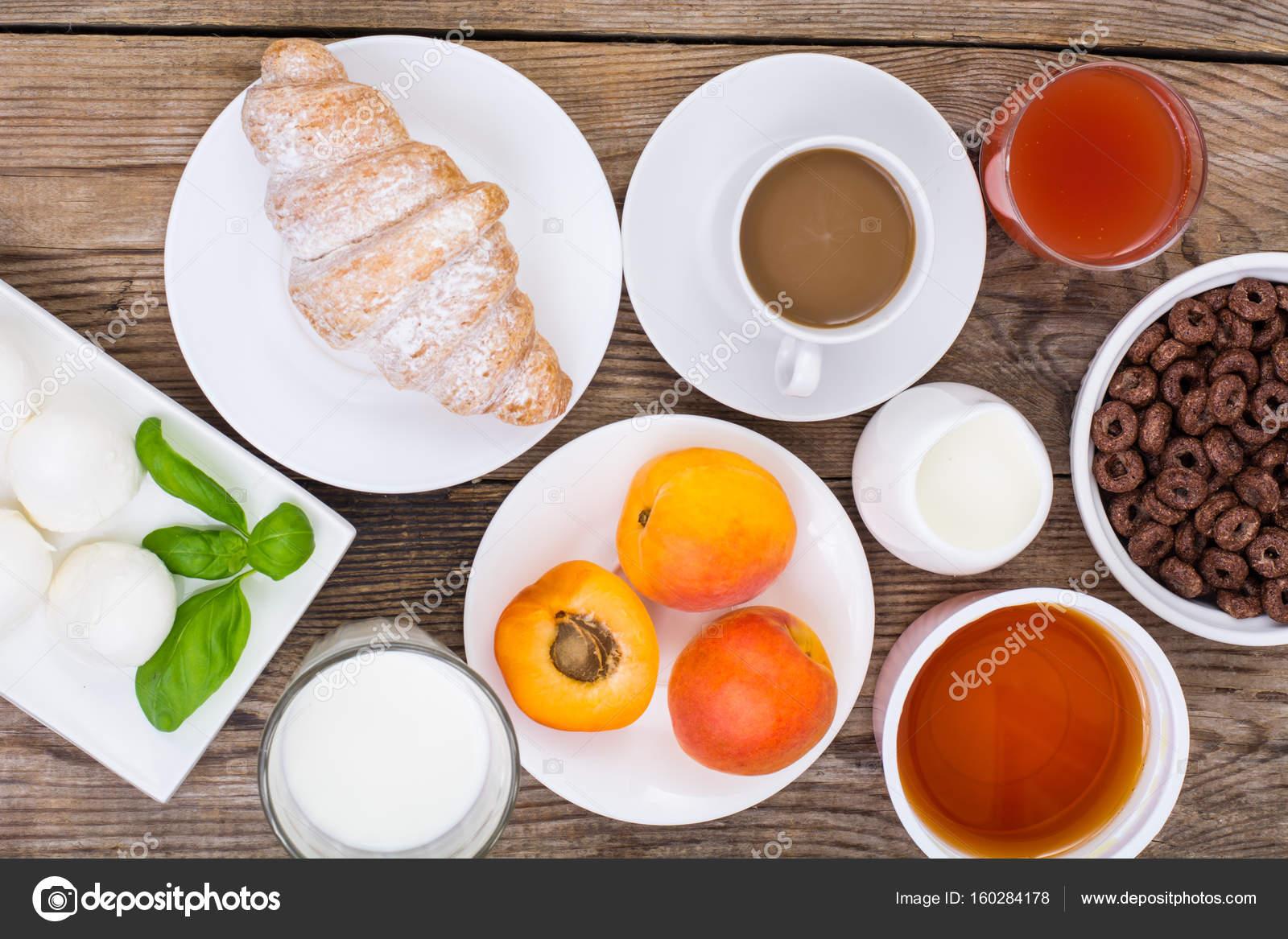 Breakfast table setting with chocolate flakes mozzarella jui u2014 Stock Photo & Breakfast table setting with chocolate flakes mozzarella jui ...