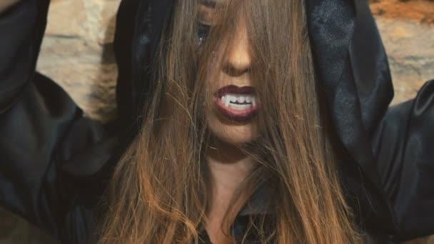 Devilish female vampire scaring on the camera