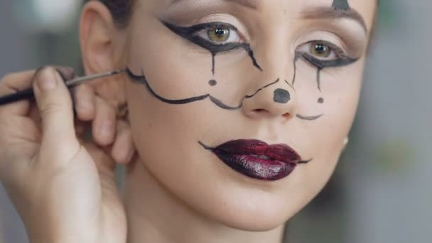 Make up artist make the girl halloween picture of mouse