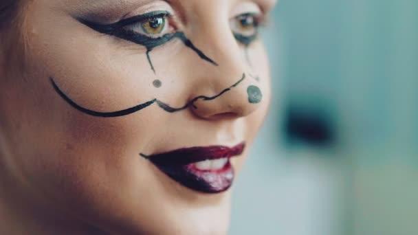 Applying halloween makeup for the girl