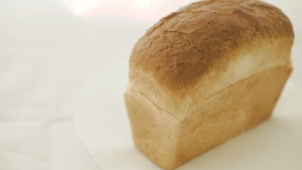 Close up of wheat bread on the white background in 4K