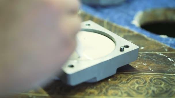Dental technician making imprint of jaw in 4K