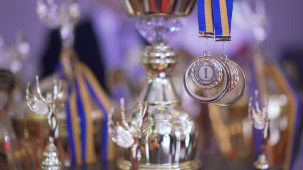 Close up of golden trophies on competition in 4K