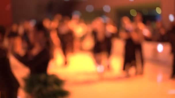 Blurred background of dancers dancing ballroom dances on competitions in 4K