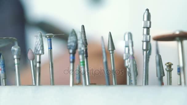 Dental instruments on background of dentist making model of jaw
