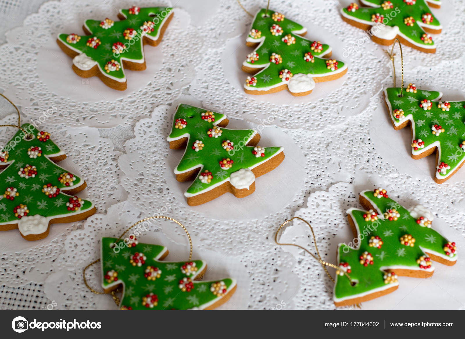 Painted Gingerbread In The Shape Of Christmas Tree On A White Napkin
