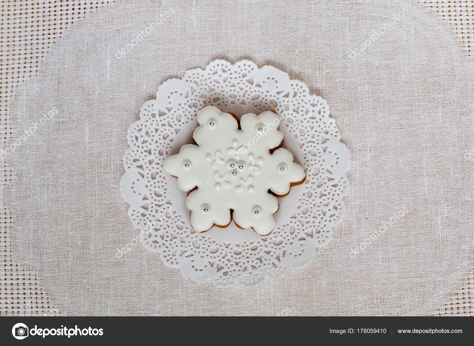 Copo de nieve de jengibre Navidad sobre un fondo de la servilleta ...