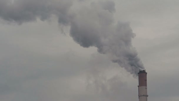 Smoking pipe of thermal power plant on cloudy background
