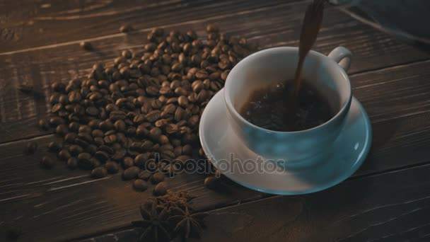 cup of black coffee with beans over grunge wooden table