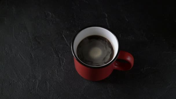 Cinemagrah, red mug with coffee on black background