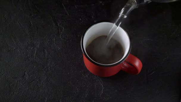 Red mug with coffee on black background