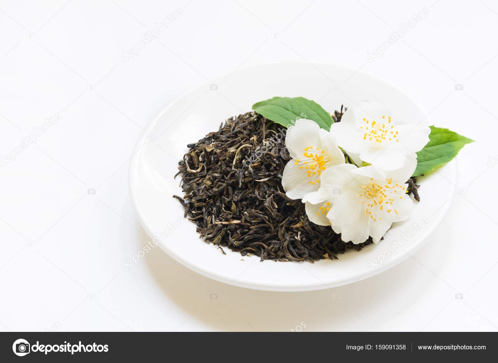 Jasmine Dry Green Tea On White Plate With Decor From Fresh Jasmin