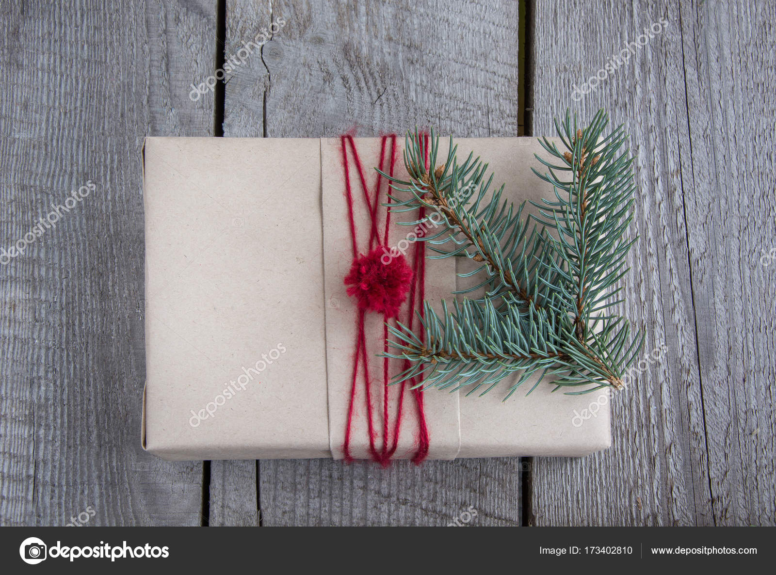 Christmas Gift Box On Wooden Table Handicraft Wrapping Fir Tree