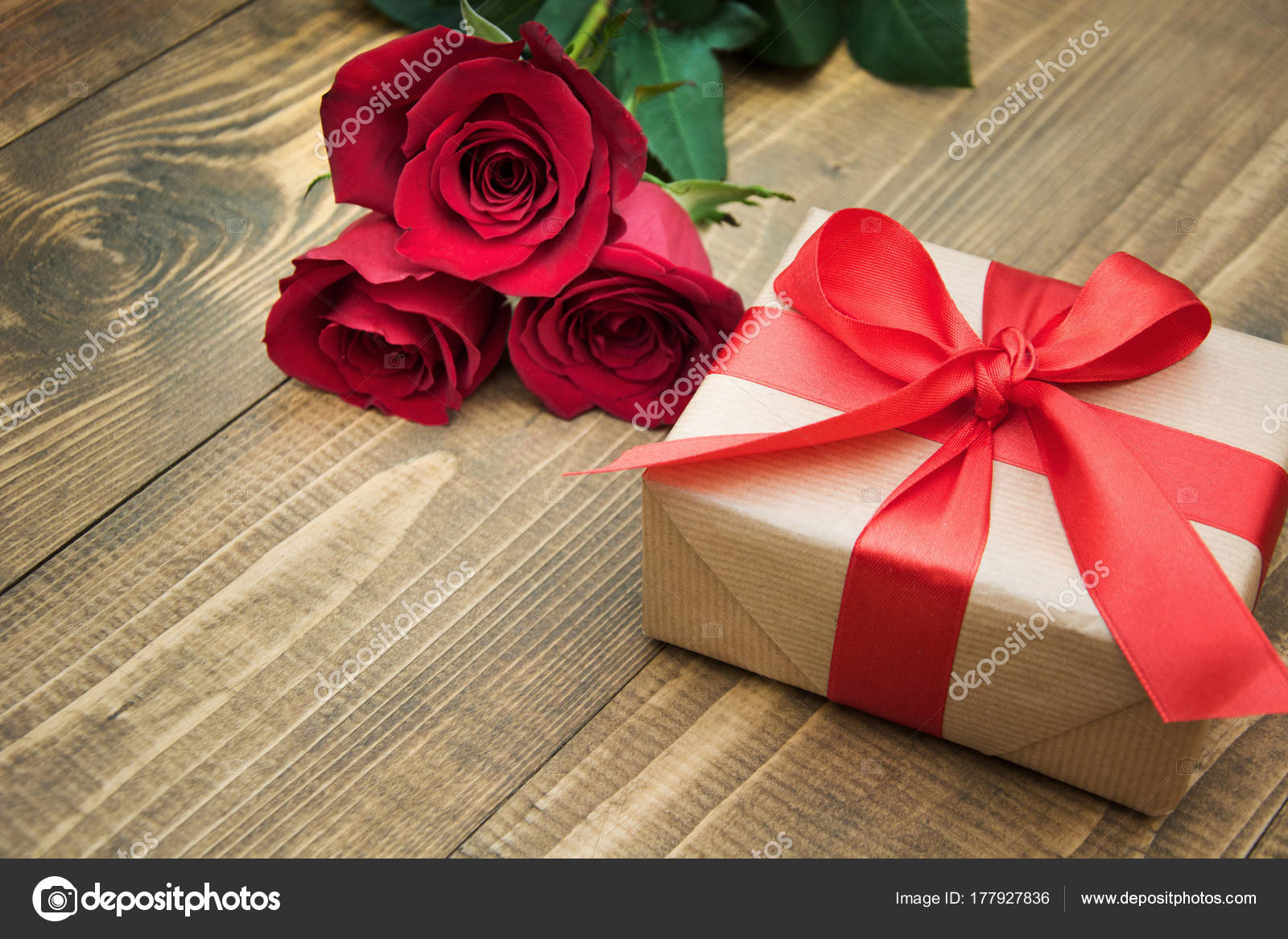 Gift With A Red Ribbon And A Bouquet Of Roses On Your Birthday Or