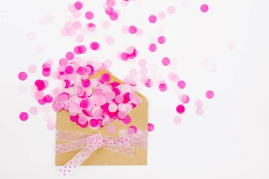 Pink paper confetti fly out enoverta, holiday concept