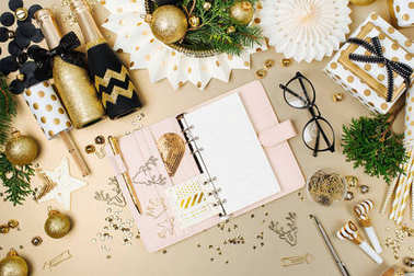open planner on desk with Christmas decorations