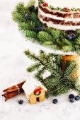 Fotografie Gingerbread house with decorated fir branches and berries