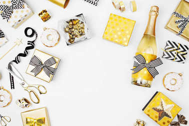 Christmas set with gift boxes, champagne bottle, bows, decorations in golden and black colors