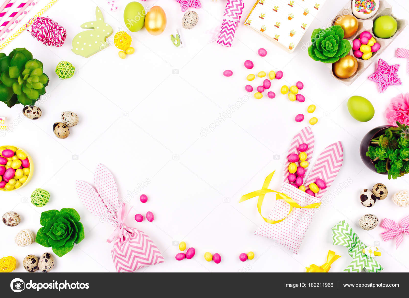 top view workspace easter decoration bunny gift bags candies stock
