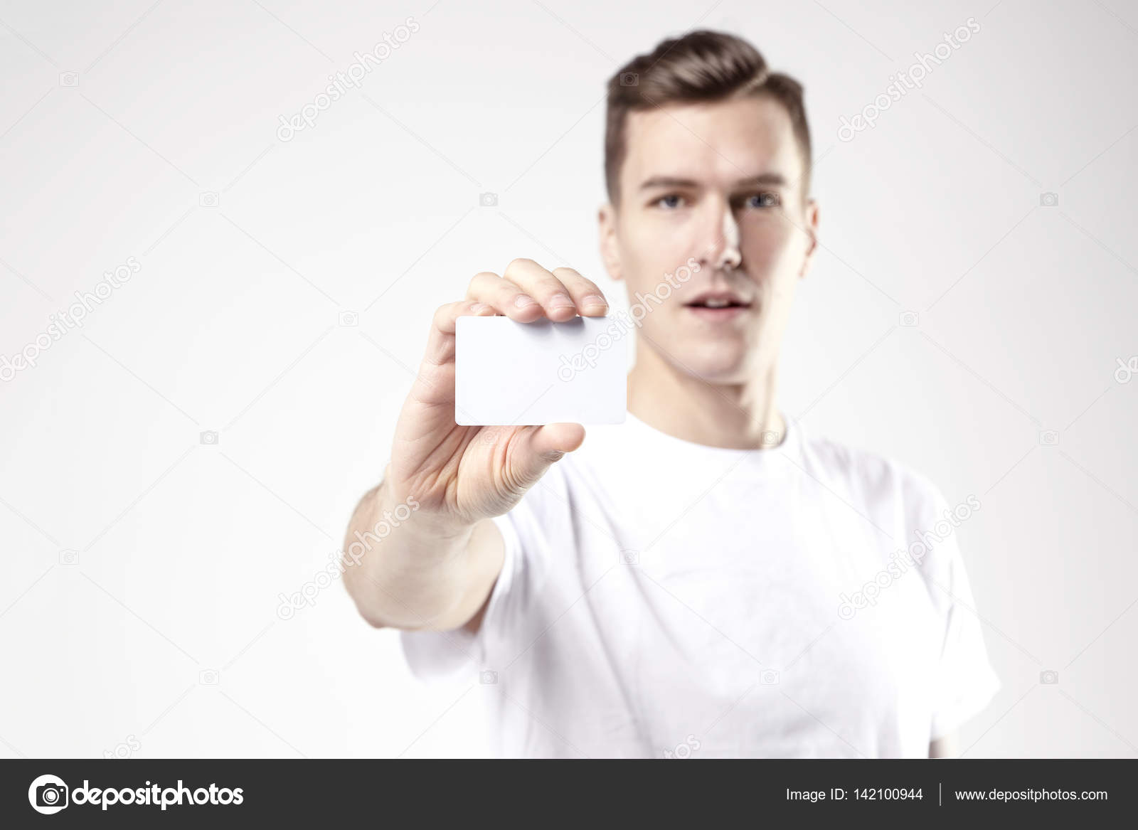 Portrait of attractive businessman holding blank business card ...