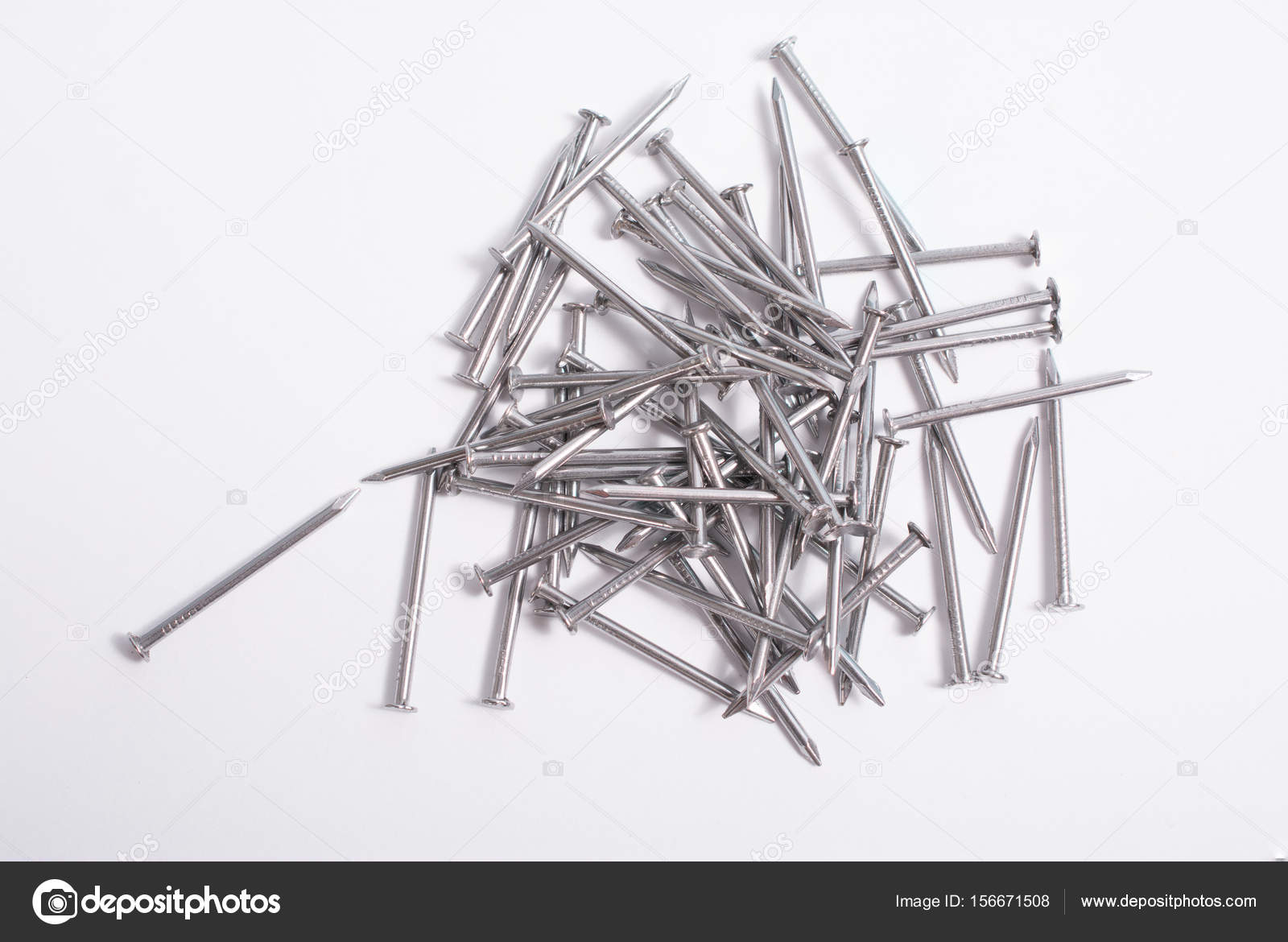 Silver finishing nails on white — Stock Photo © Chinook203 #156671508