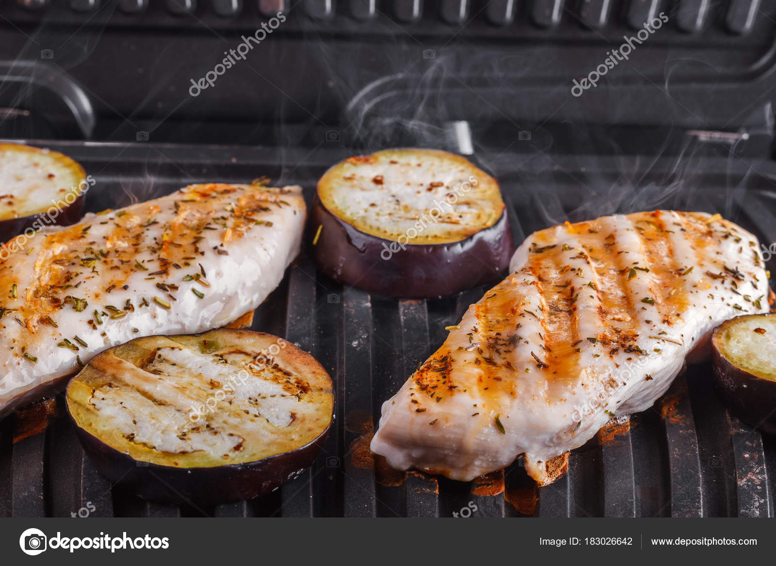 Fillet Of Chicken Breast And Eggplants Cooked On Electric Grill