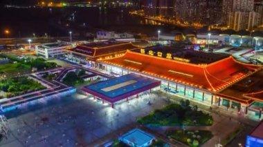 china night time illuminated zhuhai city traffic street crossroad aerial panorama 4k time lapse
