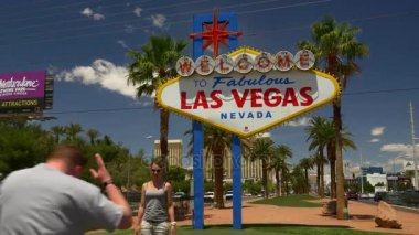 Tourists near Las Vegas sign