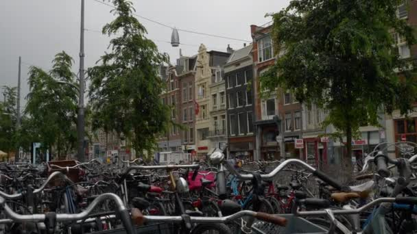 Amsterdam city center cloudy day canal bicycle traffic bridge panorama 4k Netherlands