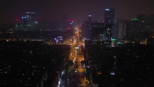 Night time illuminated Chengdu city downtown aerial traffic panorama 4k china